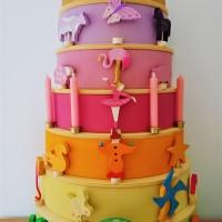 Grimm\'s regenboog verjaardagstaart