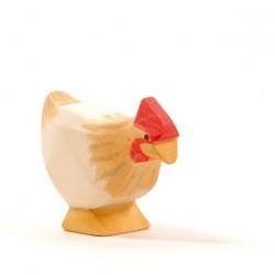 Kip oker staand